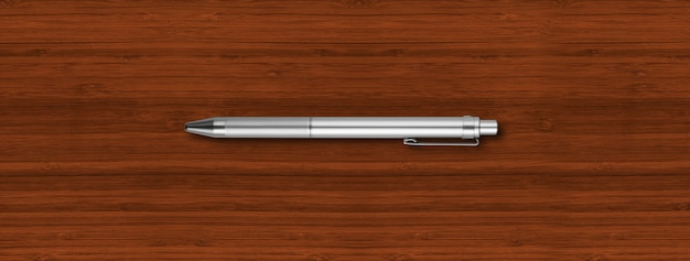 暗い木製に分離された鋼の金属ペン