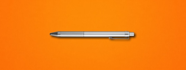 Steel metal pen isolated on orange background banner