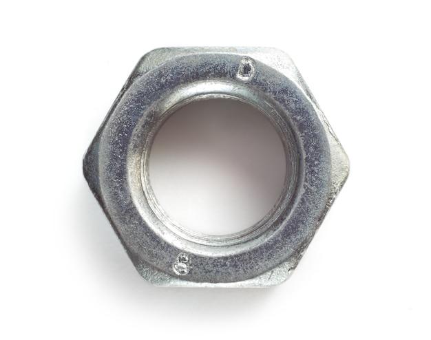 Steel nut on a white