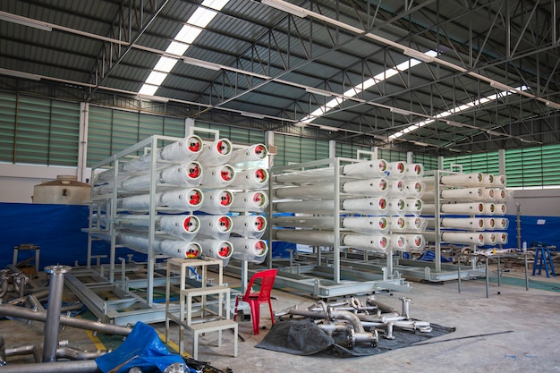 The steel pipes are stacked in the workshop warehouse. high speed extrusion line of water supply and gas pipe