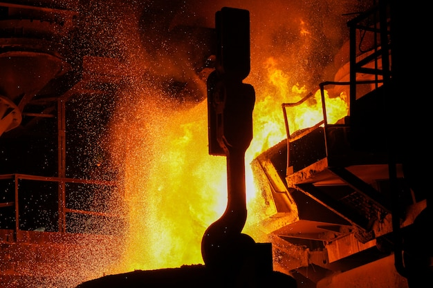 Steel production in electric furnaces. sparks of molten steel. electric arc furnace shop eaf. metallurgical production, heavy industry, engineering, steelmaking.