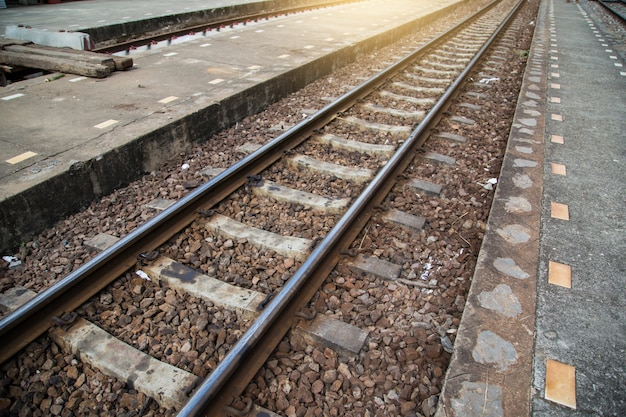 Steel rail for trains. railroad tracks with sunlight.