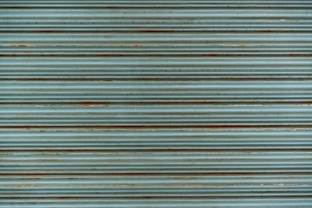 Steel rustic vintage rolling door. rustic shutter door texture. perfect for background.