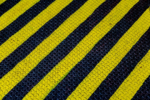 Steel sheet with yellow and black strip