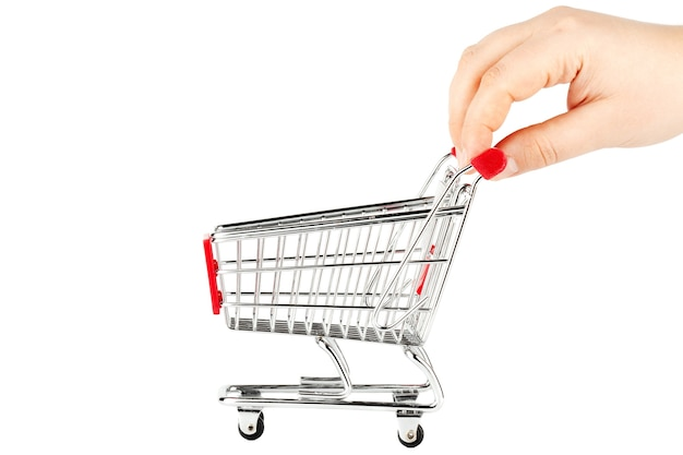 Steel shopping cart with hand on the white background