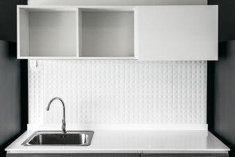 Steel sink in modern white kitchen clean interior design