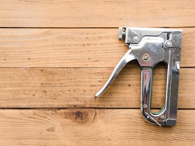Steel staple gun on table