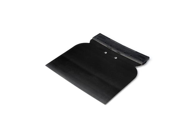 Стальной шпатель для заполнения пространства между плитками.