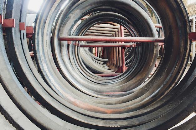 Steel tubes against industrial blurred . metal