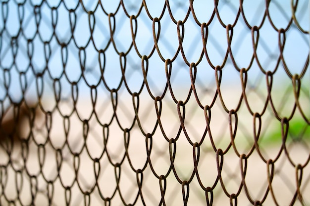 Steel wire fence to prevent dangerous areas along the beach