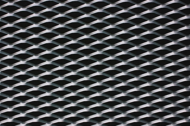 Steel wire mesh grille at the front of the building. black and white texture