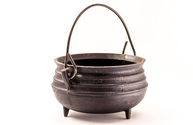 Steel witch cauldron, halloween decorative object on isolated white surface.