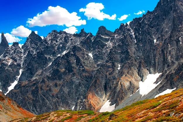 The steep snowy peak on a beautiful sunny day on kamchatka peninsula