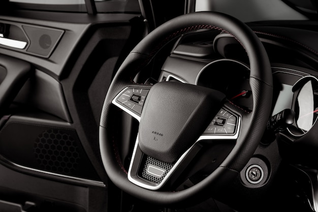 Steering wheel of a new car, interior cabin, luxurious details