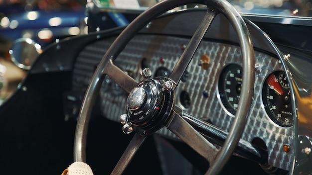 Steering wheel of vintage car.