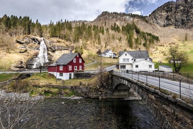Steinsdalfossen waterfall with souvenir shop in steine