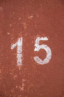 Stencil number fifteen on a red background
