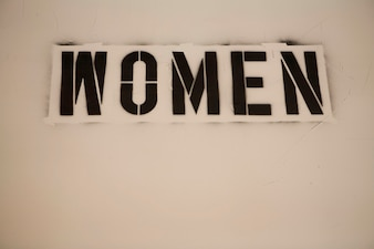 Stenciled Sign on Wall, Women