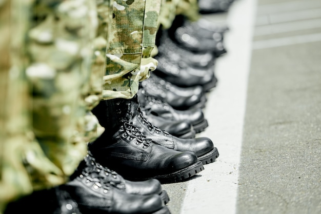 A step ahead, military army boots in row