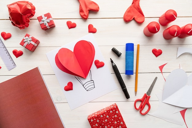 Step by step instruction making paper heart shape hot air balloon. step 8 - your heart shape hot air balloon is ready, write some greetings Premium Photo