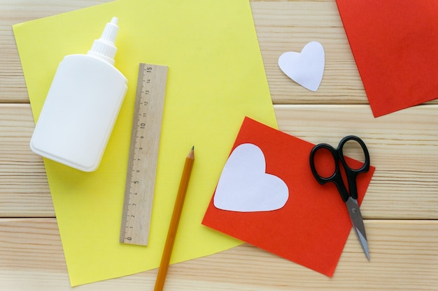 Step by step instructions. making children's valentine for holiday, top view.