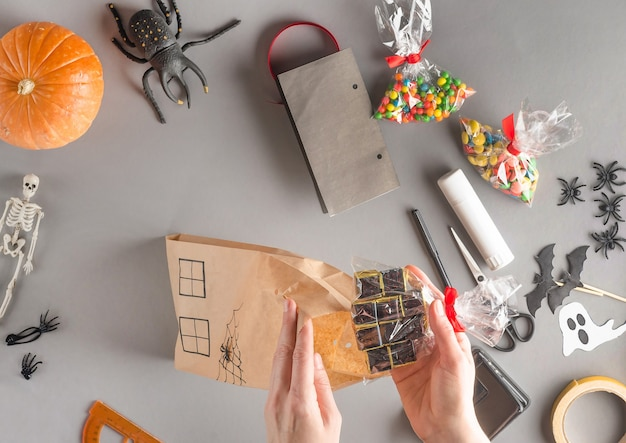 Step-by-step wrapping of a gift for halloween