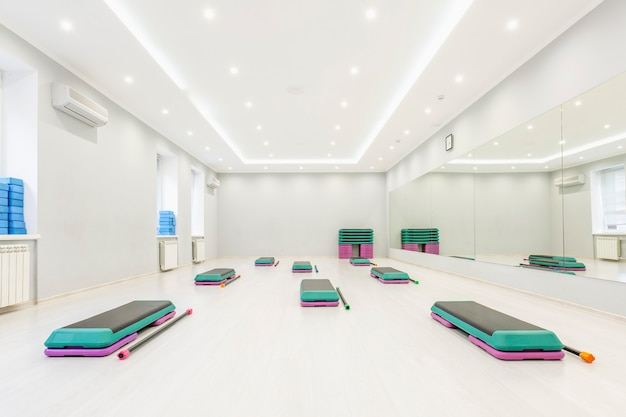 Step platform in a large, light, empty aerobics room. active lifestyle and sports.