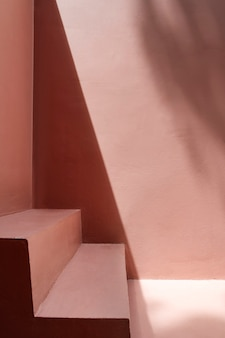 Steps by a pink wall with shadows