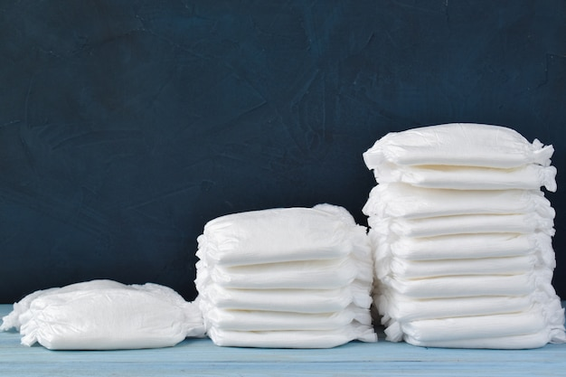 Steps of diaper stacks on a wooden table