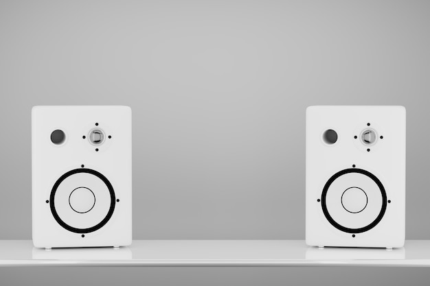 밝은 배경에 흰색의 스테레오 음악 스피커. 기둥 사이에 디자인을 위한 공간입니다. 3d 렌더링.