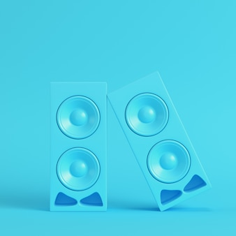 Stereo speakers on bright blue background in pastel colors