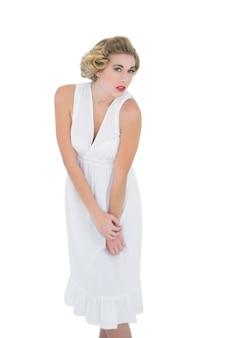 Stern fashion blonde model looking at camera