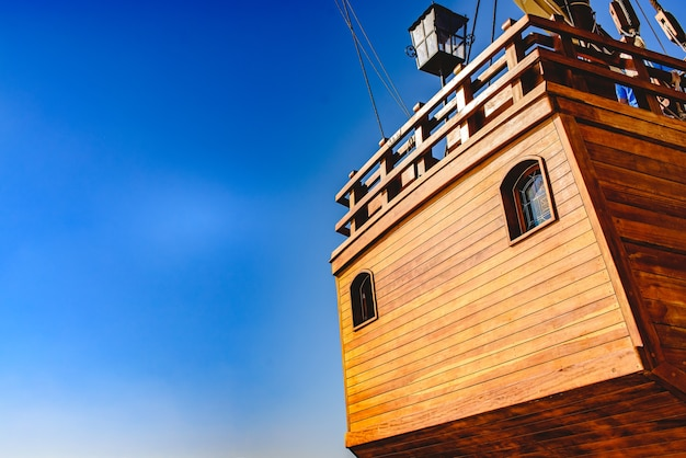 Stern of old galley docked in port to navigate the ocean in the discovery of america.