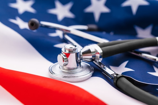 Stethoscope on american national flag, close up