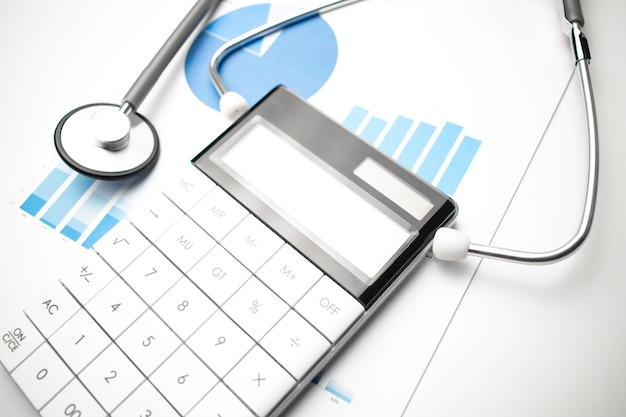 Stethoscope, calculator and documents. medical and insurance concept