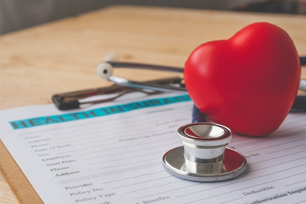 Stethoscope and calculator placed on health insurance documents, individual medical health insurance. concept life planning