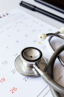 Stethoscope on the calendar with soft-focus and over light in the background