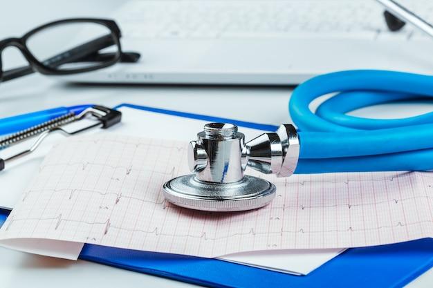 Stethoscope on cardiogram sheet