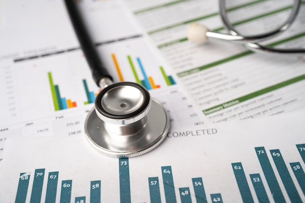 Stethoscope on charts and graphs paper finance account statistics investment