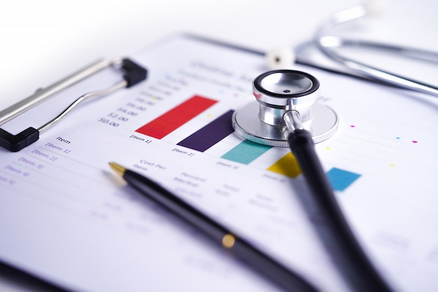 Stethoscope, charts and graphs spreadsheet paper.