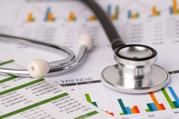 Stethoscope on charts spreadsheet paper
