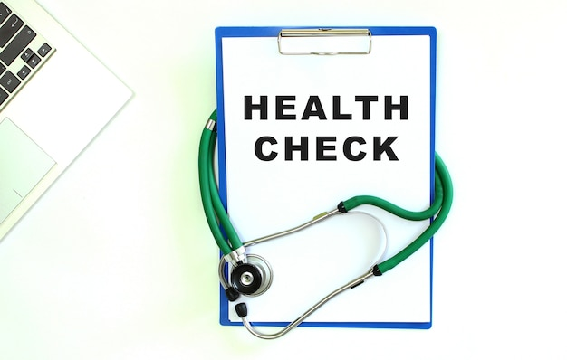 Stethoscope and clipboard with blank white sheet of paper and copy space.