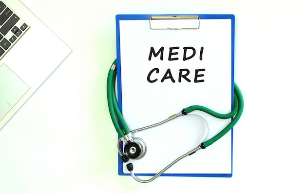 Stethoscope and clipboard with medi care text on white sheet of paper and copy space