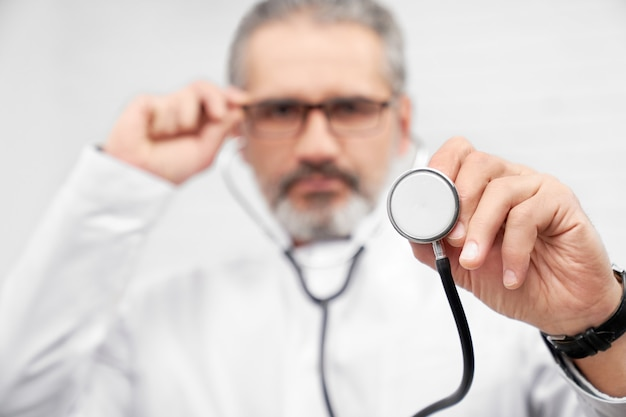 Stethoscope close up, doctor showing medical equipment.