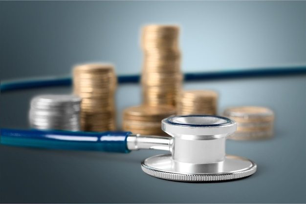 Stethoscope on currency coins for financial examination healthy concept