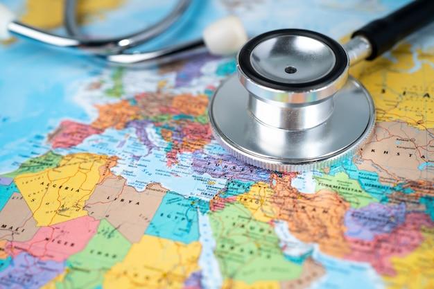 Stethoscope on europe world globe map.
