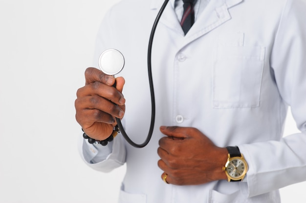 Stethoscope in focus in hand of doctor