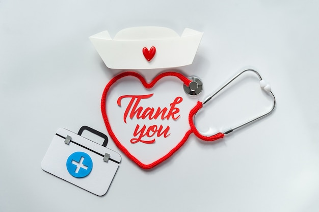 Stethoscope forming heart with its cord. thank you doctor and nurses and medical personnel team.