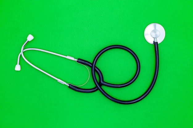 Stethoscope on green background concept world health day background.