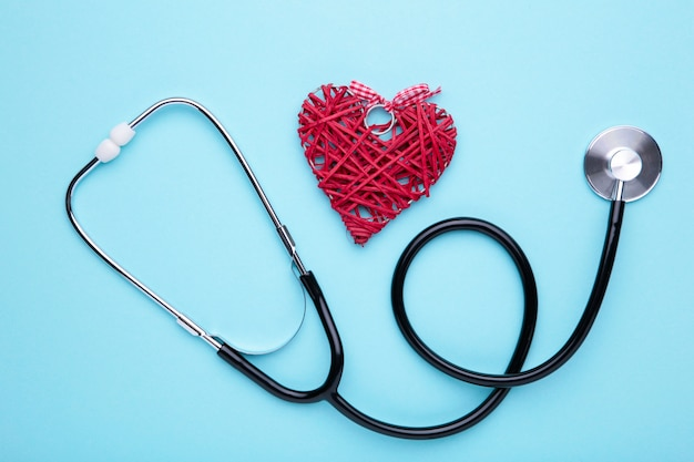 Stethoscope and heart on blue